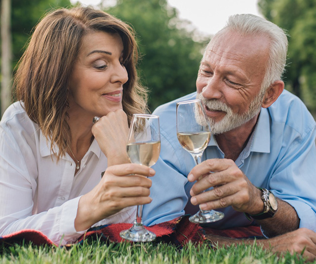 senior-couple-at-park-with-wine